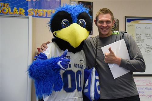 "Jon Cody, teacher at MRES, is recognized by AFA mascot Sept. 21 as part of their ""Extra Yard for Teachers"" campaign."