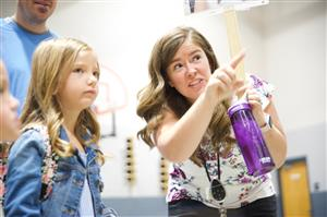 RVES first-grade teacher Katharina Bock show Hallie Krug where to line up for her first day of school