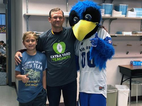 "Mark Koenig, teacher at RES, receives accolades from student and AFA as part of ""Extra Yard for Teachers"" campaign."