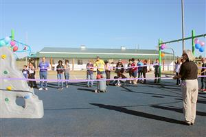 Students and staff celebrate at ribbon cutting ceremony for new playground at PEAK Education Center Aug. 30.