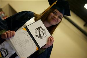 PPEC Grad Bridget Olson with her high school diploma