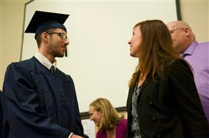 PPEC graduate Thomas Palma accepts his diploma