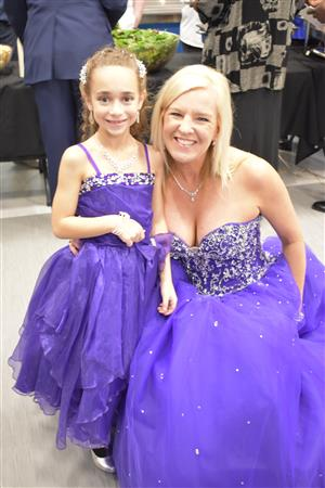 Torey Heberer (left) and her mother, Eagleside Elem. Assistant Principal Amanda Heberer (right) mingle at the S2S Purple Ball