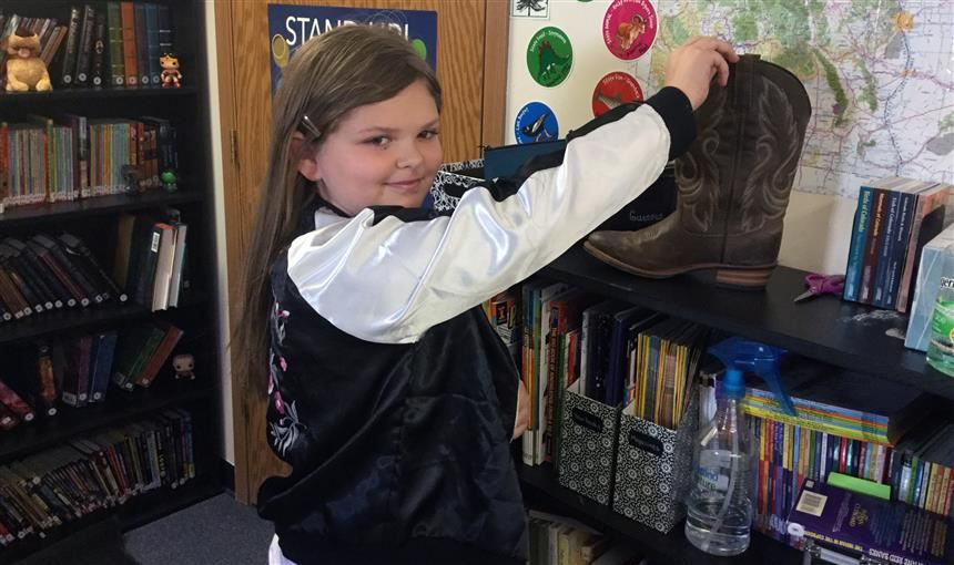 Girl gives spare change at RVES in September to help school in Texas affected by Hurricane Harvey.