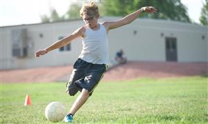 Raiden Ruiz-Stell, HMS sixth-grader, lines up a shot during a SeSSI soccer game on July 2
