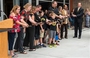 School leaders and future Bennett Ranch Elementary School students line up for the ribbon-cutting.