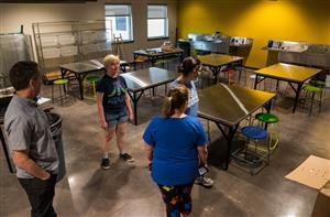 Visitors tour new classrooms following BRES ribbon-cutting, July 23.