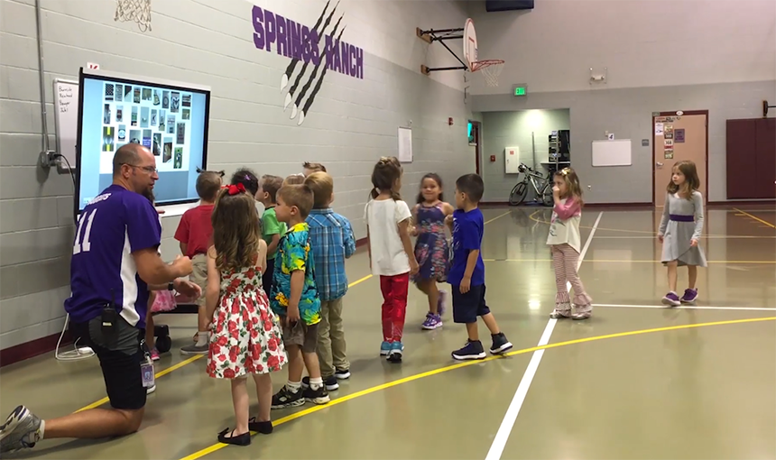 SRES physical education teacher Jeff Ingram welcomes kindergarteners to his class.