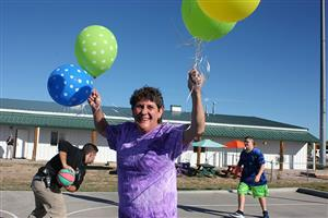 Dean of PEAK Programs shows her excitement for new playground at PEAK Education Center Aug. 30.