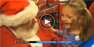Students facing special circumstances get the full treatment during Santa's Toy Express.