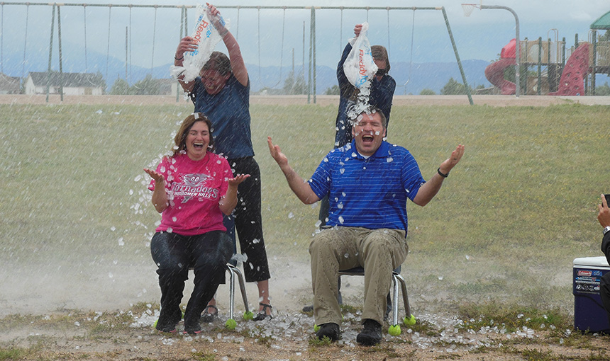 Kelly Warren and Mike Miller take the ALS ice bucket challenge with the help of Falcon Fire.