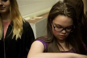 Dokata Brockel, eighth-grader at SMS, practices a poem backstage of the SMS MLK Concert in April