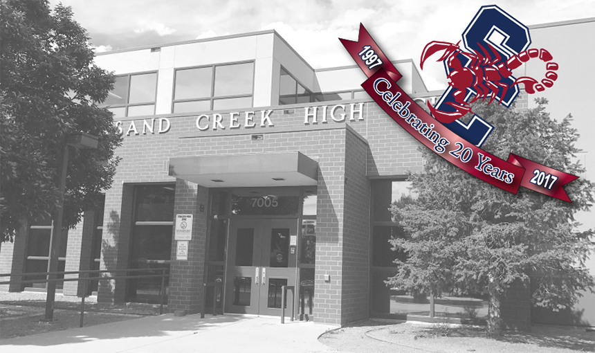 Sand Creek High School front entrance with 20th anniversary logo