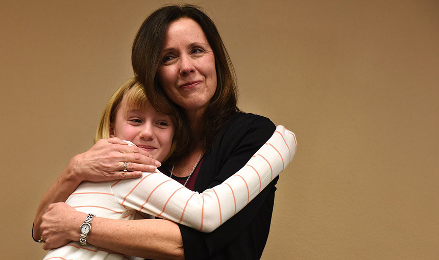 Lani Bryan, a fifth-grade teacher at SRES is embraced by student Madison Madison Nahrgang, 10.