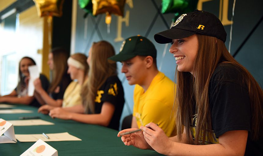 Coaches, Families Celebrate 6 Athletic Scholarships