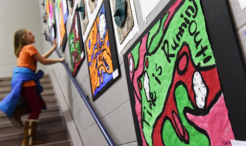 A student looks at art from other Sand Creek Zone students at the third annual art & design expo.