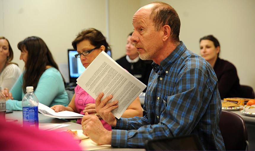 Peter Falldorf, PPCC Anatomy and Physiology Professor, meets with D49 educators.