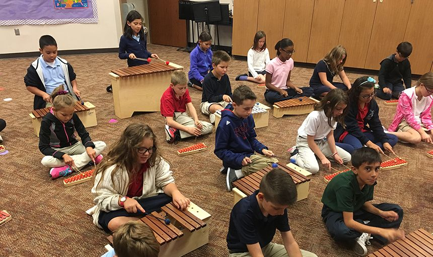 RMCA fourth-graders explore music using xylophones in Julie Seibert's elementary music course.